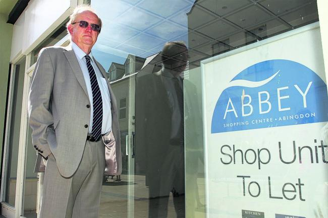 Sandy Lovatt with one of the large shops empty six months after the £4.5m revamp of the Abbey shopping precinct. Picture: OX60488