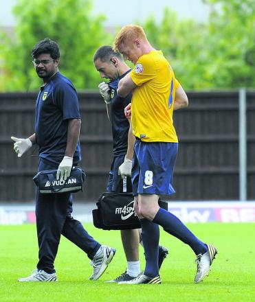 Injured Dave Kitson leaves the field during the Bury game last Saturday