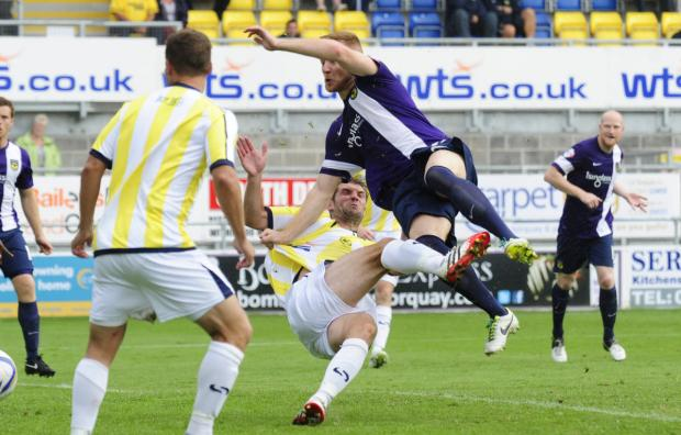Goal machine Deane Smalley flies through the air in acrobatic fashion to open Oxford United's account in the 3-1 win at Torquay
