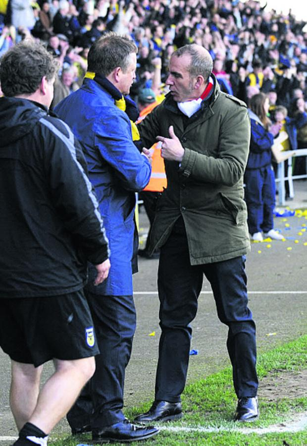 Herald Series: Paolo Di Canio has words with Oxford United boss Chris Wilder at the Kassam Stadium in March 2012 during his spell at Swindon