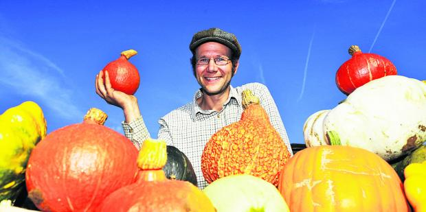 Organic farmer George Bennett with his squashes at the Thame Food Festival