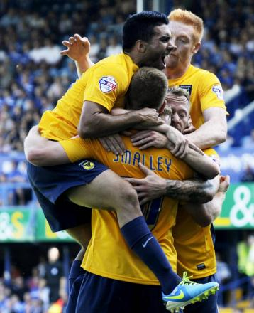 Deane Smalley is mobbed after scoring the first of his two goals at Portsmouth