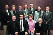 Didcot captain Stephen Gates proudly holds the Division 4 trophy as he lines up with his team at the presentation night