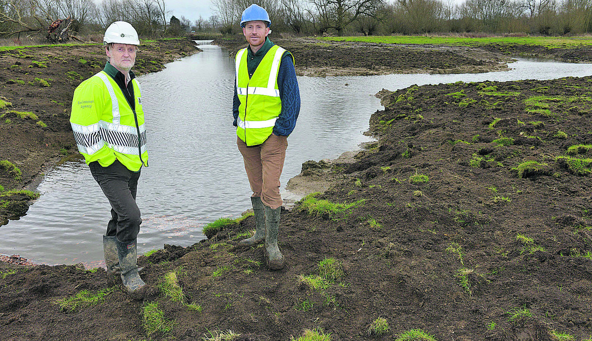 Graham Scholey, left, biodiversity specialist from the Environment Agency, and Chris Parker, head of land management for the Earth Trust, by one of the new backwaters at North Farm in Wallingford