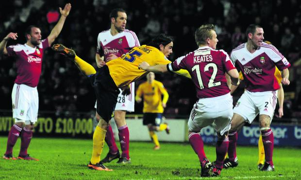 Ryan Williams heads in the winner at Wrexham last month to put United into the third round