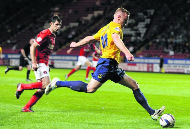Herald Series: Deane Smalley gets in a cross at the Valley in August, when Oxford United lost 4-0 in the Capital One Cup. The U's will be out for revenge when the teams lock horns again in the FA Cup
