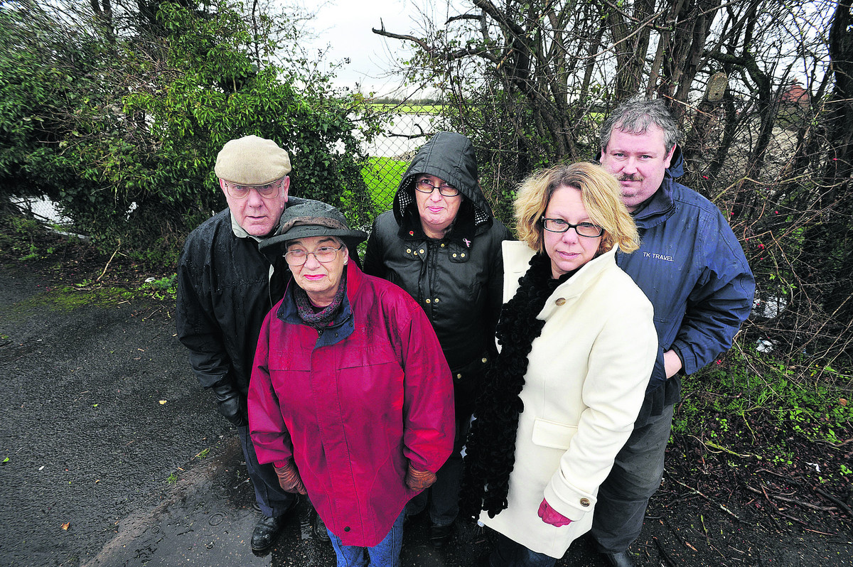 From left, Residents Eric and Betty Webb, Carole Denton, Vikki Hemming and Tim Taylor in front of the field where 31 homes are planned. Picture: OX64424 Jon Lewis