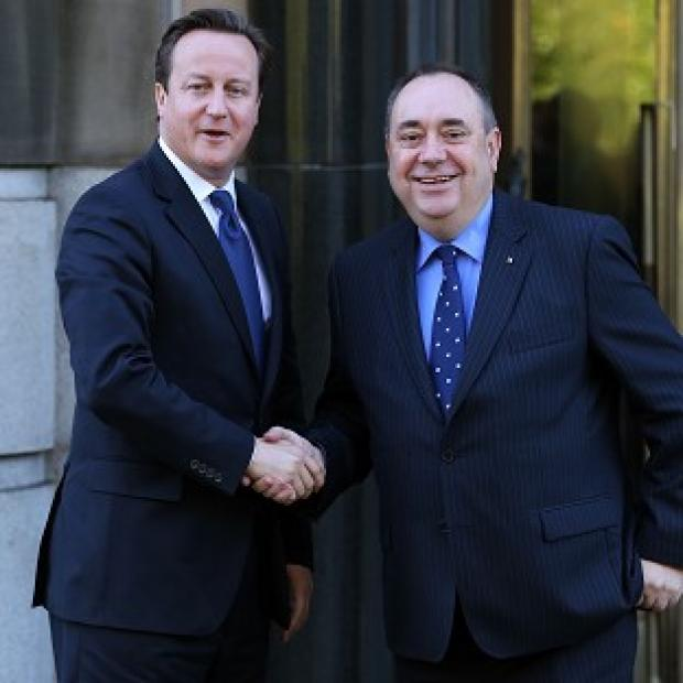 Herald Series: Pressure is mounting on David Cameron to enter into a face-to-face debate with Alex Salmond on Scottish independence