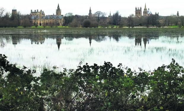 Herald Series: Reflections in the water at Christ Church Meadow in Oxford yesterday
