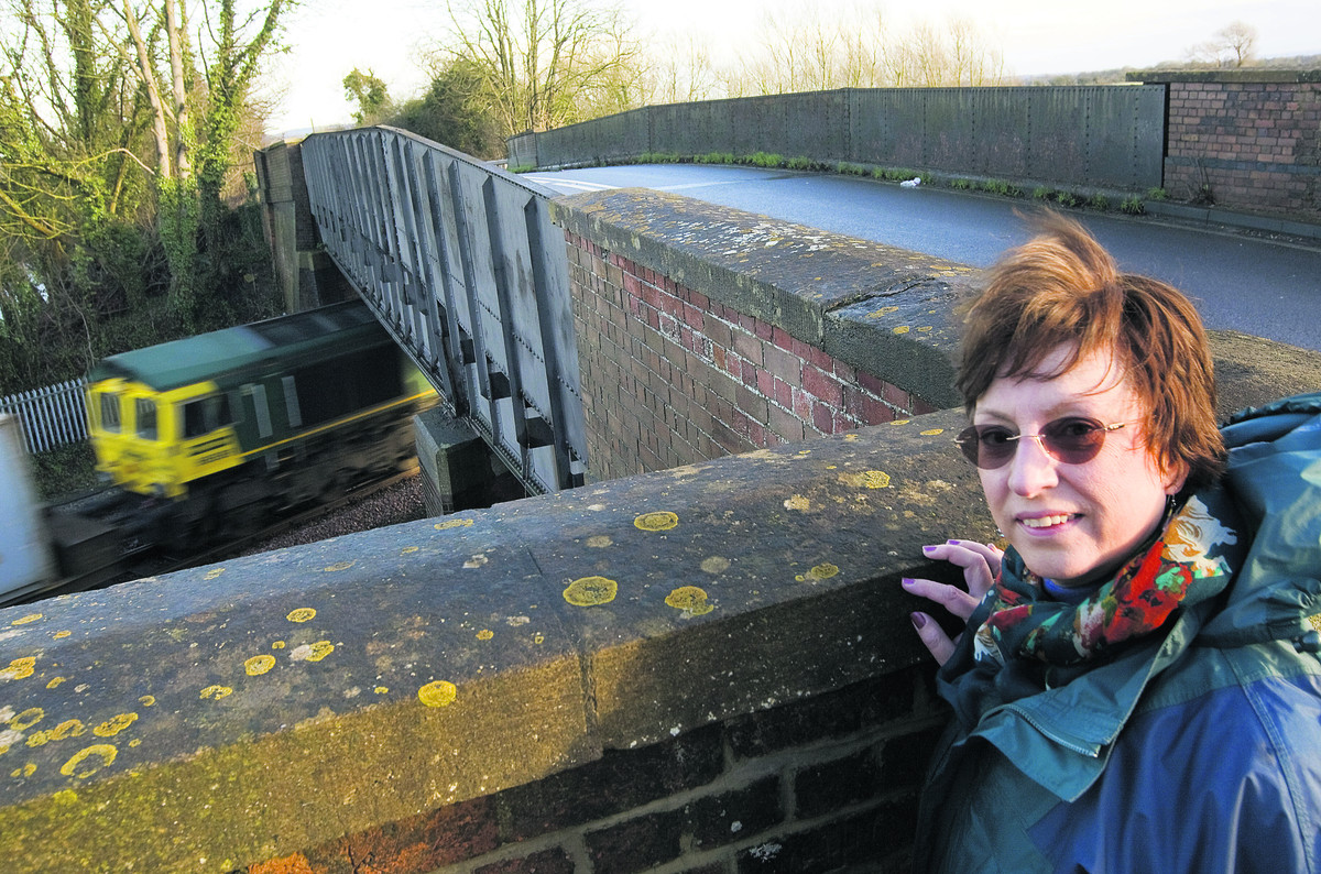 Wantage and Grove Campaign Group leader Julie Mabberley on the rail bridge on the A338 which Network Rail has permission to close from February 10. Picture: OX64461 Antony Moore