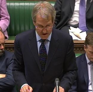Herald Series: Environment Secretary Owen Paterson has been answering questions from MPs on the recent floods