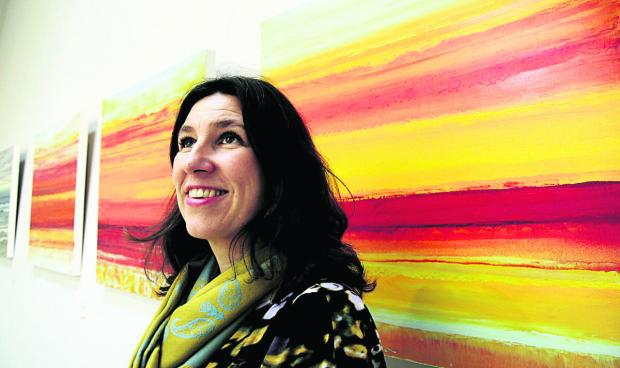 Artist Janine Philips with some of her work at the Cornerstone Arts Centre Picture: OX64544 David Fleming