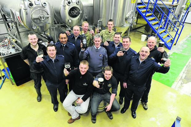 RAF Benson Reserves members raise a glass to new beer 606 with brewers Will Laithwaite and Chris Harrison (front from left).  Picture: OX64632 Jon Lewis