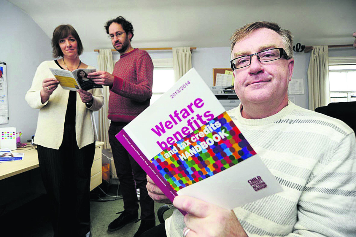 Mind Oxfordshire assistant manager Susannah Lloyd-Shogbesan, hotline volunteer Adam Moore and David Bryceland, project manager for Benefits for Better Mental Health Picture: OX64641 David Fleming