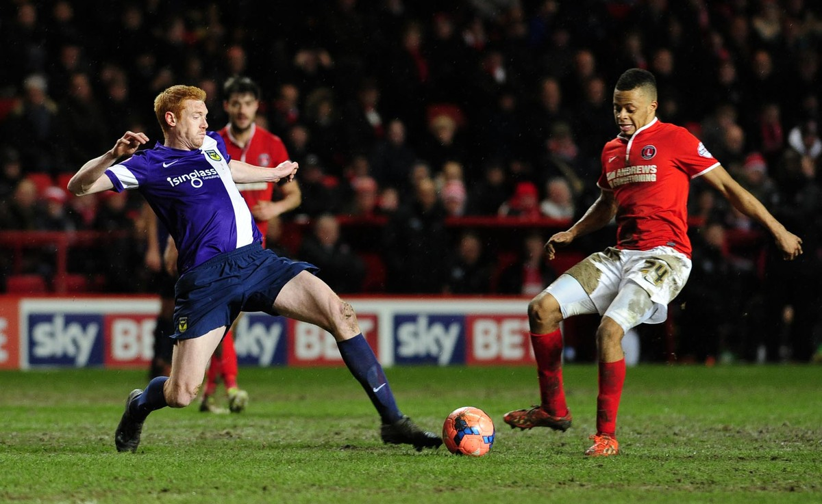Dave KItson, pictured straining to reach the ball in Tuesday's 2-2 draw at Charlton Athletic in the third round of the FA Cup, thinks Oxford United would benefit from two new signings