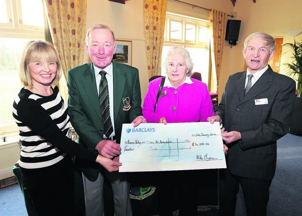 From left, Frilford Heath Golf Club ladies' captain Sue Russell and men's captain Mike Chapman hand the cheque for the air ambulance to fundraisers, Janet and Ray Dawson.  Picture: OX64609 Damian Halliwell