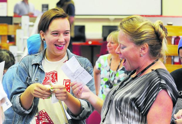 Herald Series: Dagmara Michno celebrates with Cheney School headteacher Jolie Kirby on GCSE results day last August.
