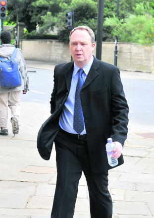 Fraudster Andrew Griffin pictured outside Oxford Crown Court in June last year