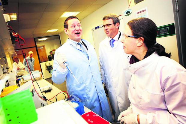 Herald Series: SCIENTIFIC: Ed Vaizey MP, left, with Milton Park managing director James Dipple and scientist Rebekka Krumbach.   Picture: OX64954 Ed Nix