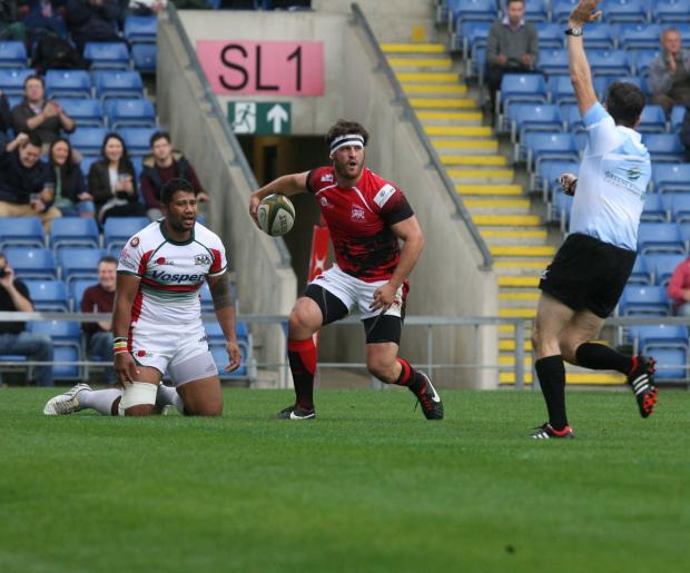 Mike Denbee celebrates scoring for London Welsh in September's 40-9 victory over Plymouth Albion at the Kassam Stadium, but Ollie Smith is expecting a tougher test tomorrow