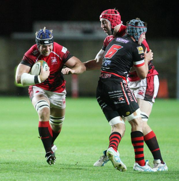 Herald Series: Richard Thorpe (carrying ball) makes a break for London Welsh as Pete Browne looks on