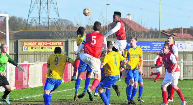 Didcot Town's Germaine Ofori has a header saved by Sam Alex