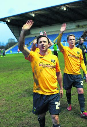 David Connolly waves to his family at the final whistle after scoring the crucial goal on his debut in Oxford's 2-1 win over AFC Wimbledon