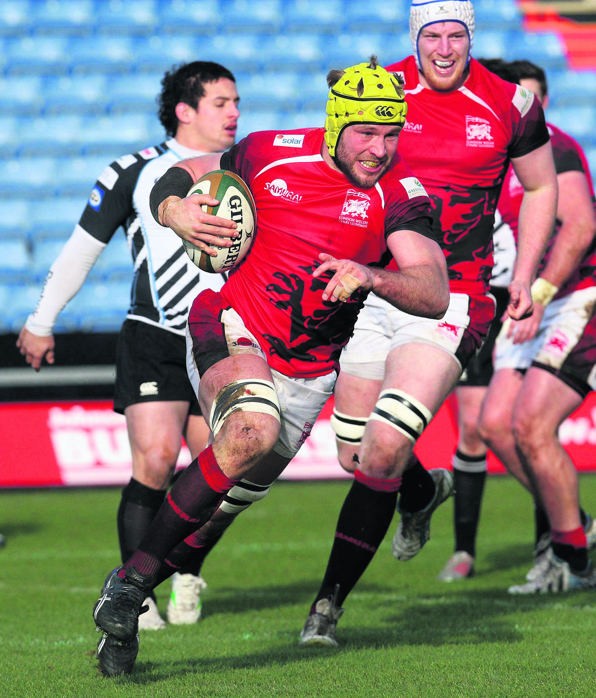 London Welsh No 8 Richard Thorpe breaks into a big smile as he races behind the posts for their second try