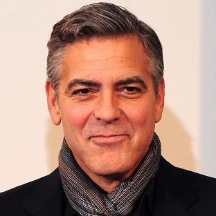 Herald Series: George Clooney attends a photocall for his new film The Monuments Men at the National Gallery in central London