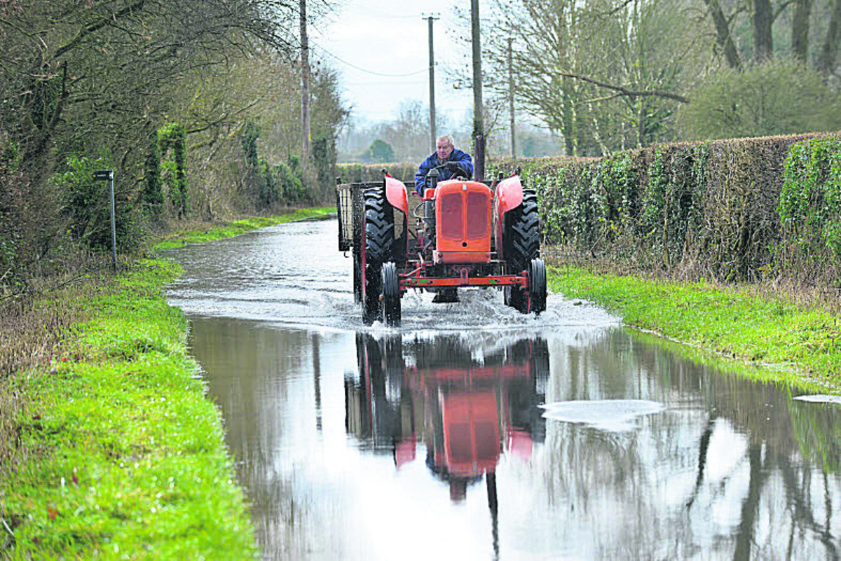 A tractor negotiates the floods in Northmoor