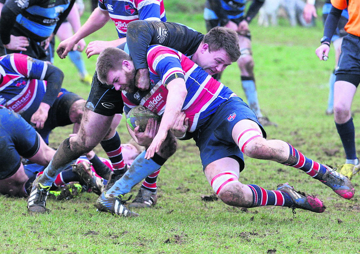 Grove's Paul Miles finds his way blocked by a tackle from Witney's Jamie Burke