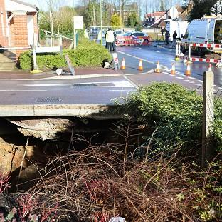 Herald Series: A view of the sinkhole in Hemel Hempstead, which is approximately 35ft wide and 20ft deep.