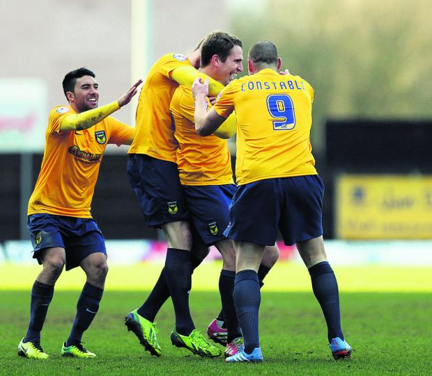 Nicky Wroe is mobbed by Danny Rose (left), Deane Smalley and James Constable after his stunning long-range effort