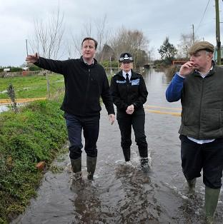 Herald Series: Prime Minister David Cameron with Bridgwater and West Somerset MP Ian Liddell-Grainger at Goodings Farm in Fordgate, Somerset