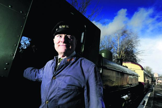 Herald Series: Engine driver Peter Bristow, 76, at Didcot Railway Centre