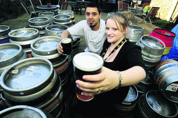 King's Head and Bell chef Luke Kenyon and assistant manager Natasha Cattemull get the pints in for the pub's beer festival this weekend