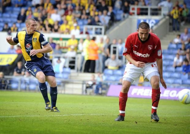 Herald Series: James Constable fires home his hat-trick goal against Morecambe at the Kassam Stadium in September 2010
