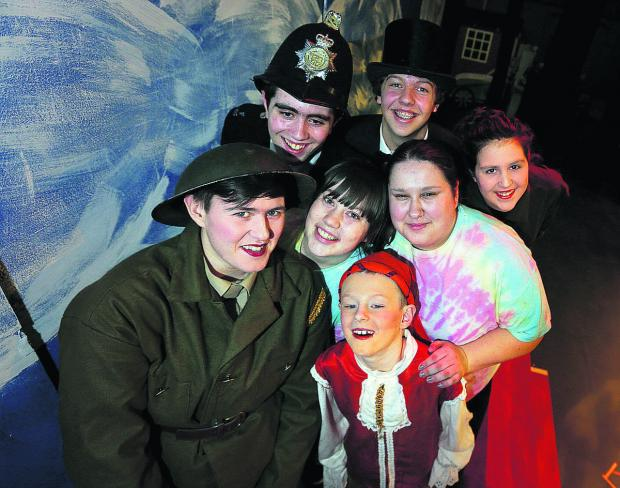 Sian Williams, 22, centre, with, clockwise from left, Scally Maule, 23, Christopher Gadd, 16, Sam Baker, 16, Bobbie Gadd, 14, Adele Fernihough, 15, and Josh Cummings, 10  Picture: OX65480 Damian Halliwell