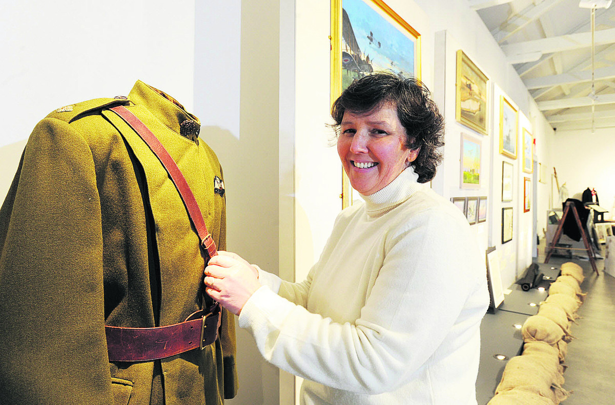 The curator of the exhibition Karen Wiseman pictured arranging the uniform of a 2nd Lieutenant of the Royal Flying Corps (RFC)