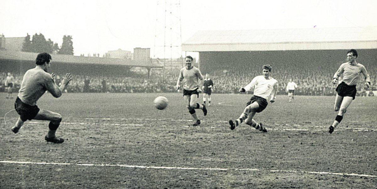 Brian Godfrey (right) makes it 2-0 to Preston just before half-time