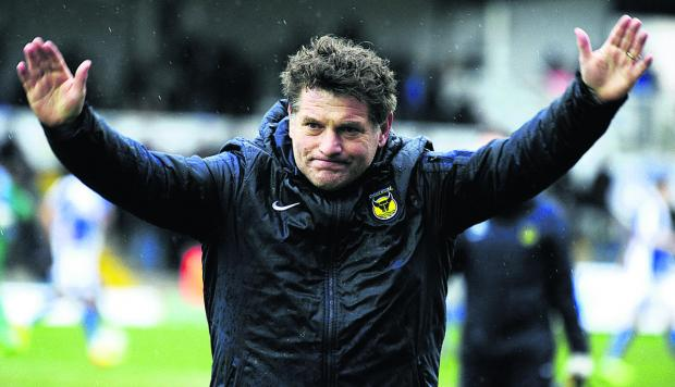 Mickey Lewis is hoping Oxford United can inflict damage on a promotion rival by winning at Rochdale tomorrow