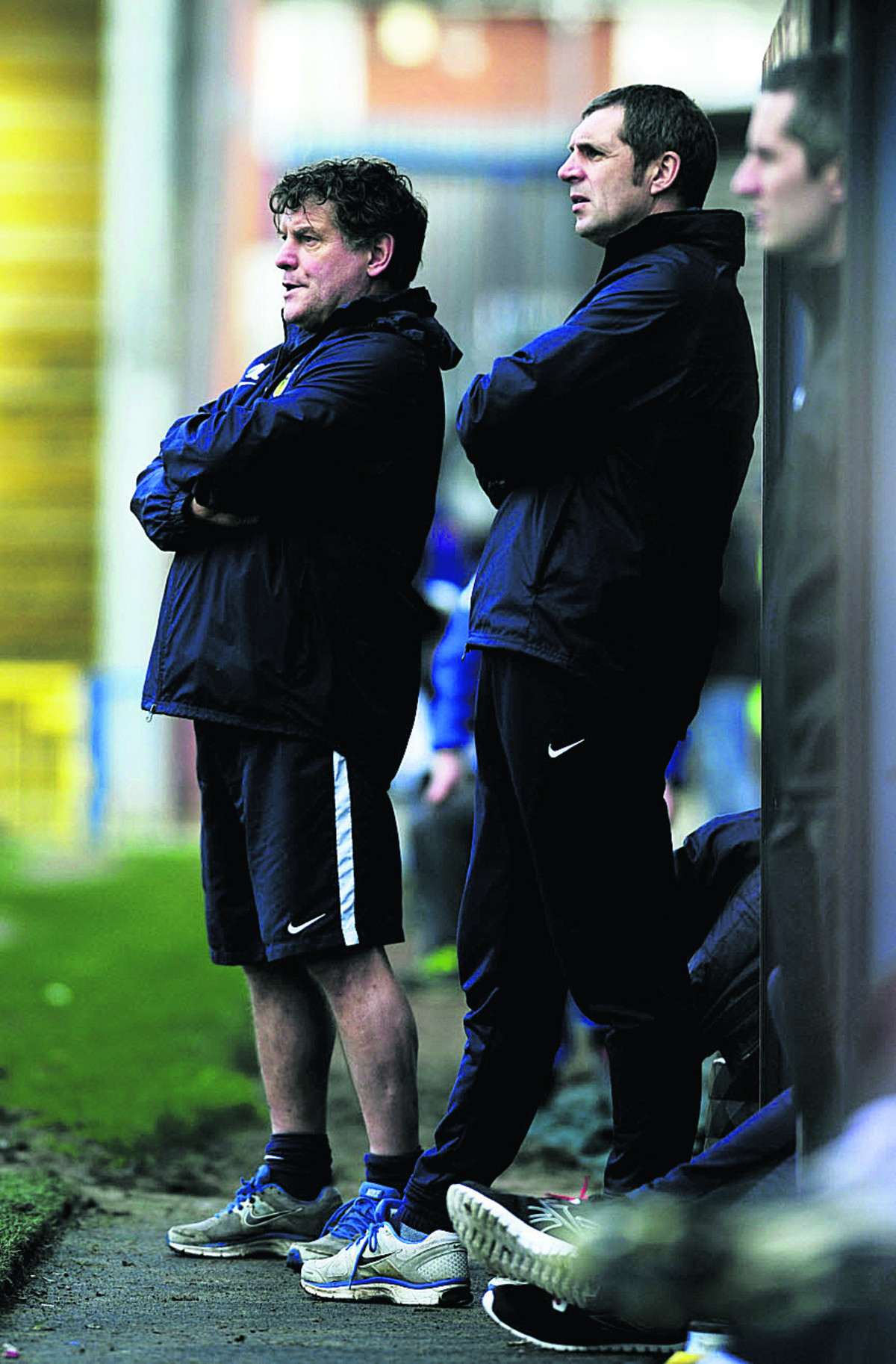Oxford United caretaker manager Mickey Lewis (left) and first-team coach Andy Melville look on during the 3-0 loss at Rochdale Picture: David Fleming