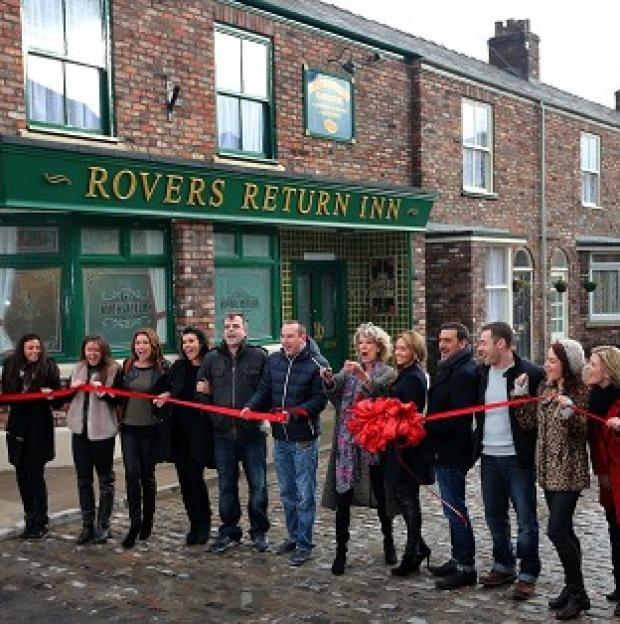 Herald Series: Coronation Street cast members on the new set, including the famous cobbles