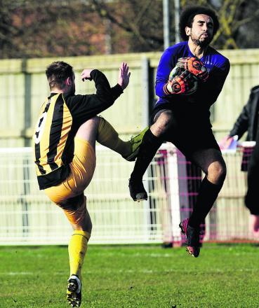 Didcot keeper Alex Williams makes sure he gets there first ahead of Tiverton 's Ryan Richards