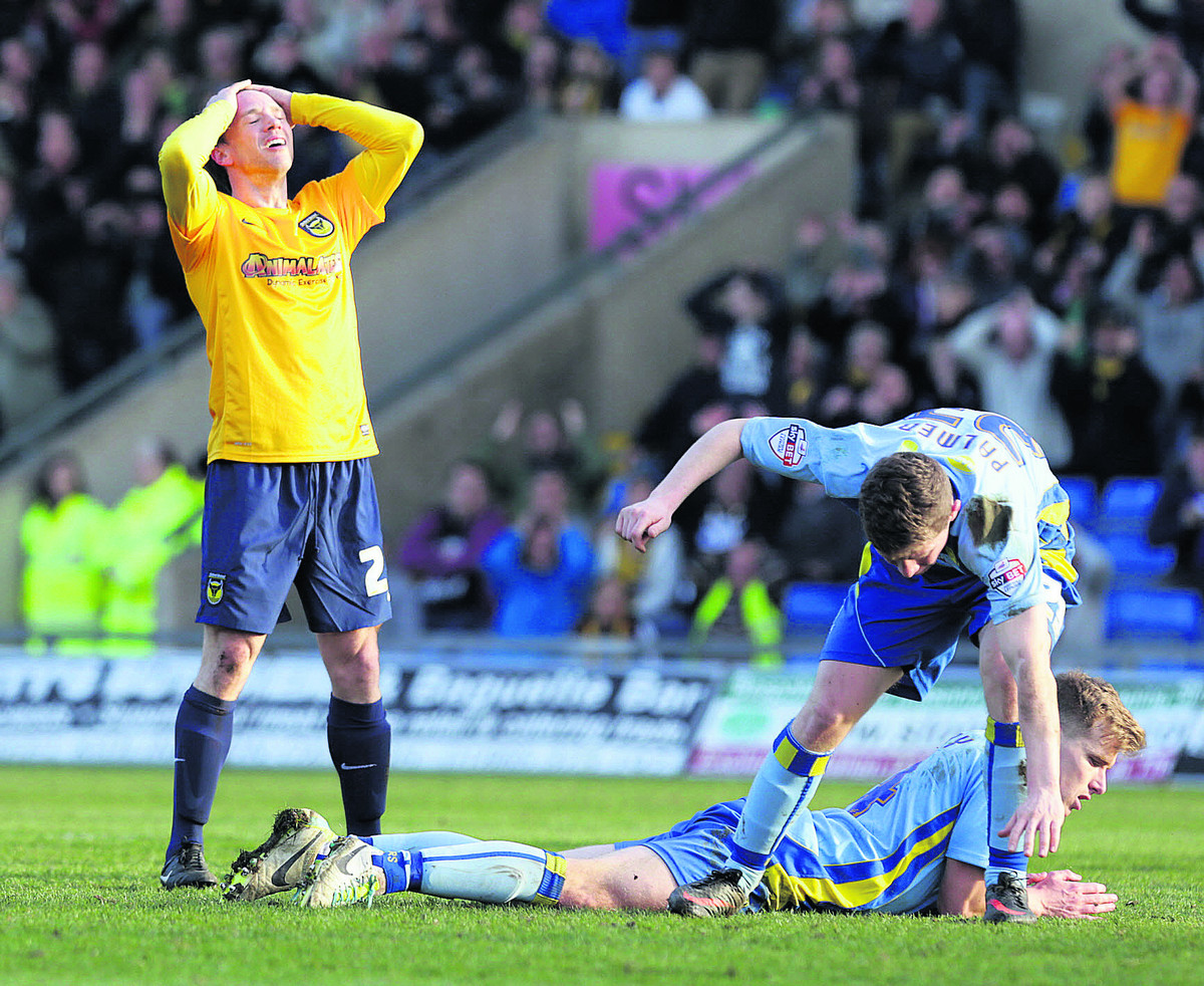 Oxford United striker David Connolly cannot believe it as Burton keeper Rob Lainton makes a stunning save to deny him an equaliser in Saturday's 2-1 defeat