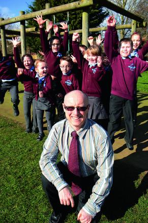 Headteacher David Mayer and pupils celebrate Ofsted inspection success