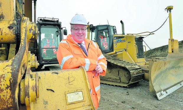 Transport Secretary Patrick McLoughlin at the site of the new rail line. Picture: OX65913 Simon Williams