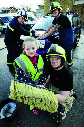 Front, Hollie Savage with her dad Will get to work with help from, back from left, retired firefighter Steve Robson and his son, new recruit Ian Robson