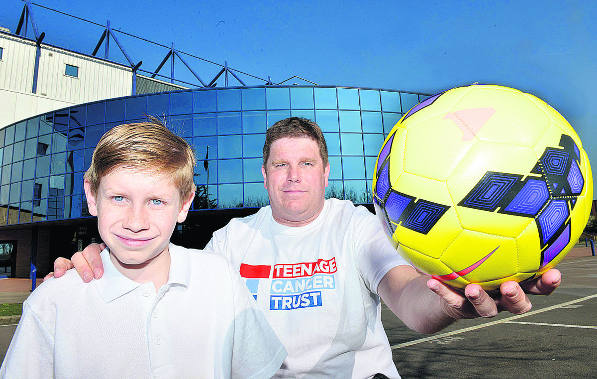 Richard Bungay, 11, and his dad Darren outside Oxford United's Kassam Stadium. Picture: OX65801 Simon Williams