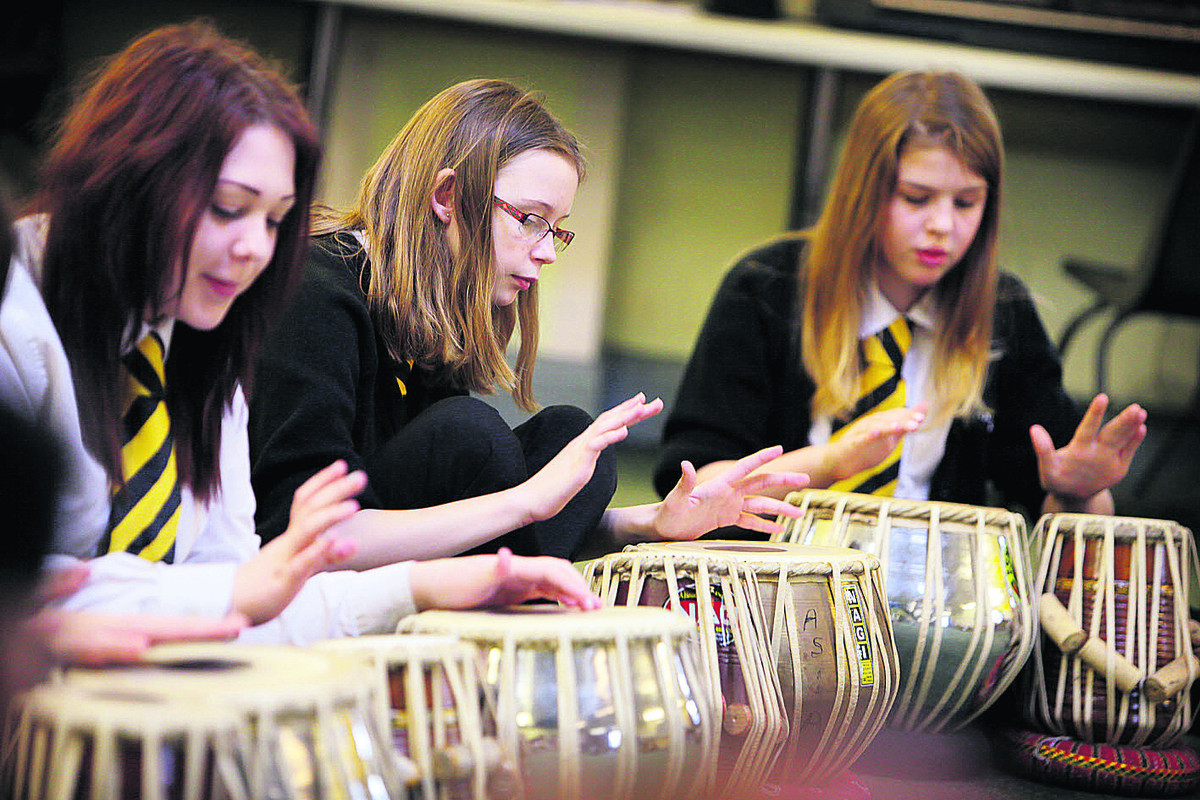 From left, Tor Lawrence, 13, Jessica Hawkins, 14, and Naomi Claridge, 13, bang the drums